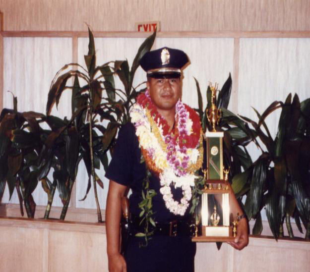 Clarence at his police acedmy graduation
