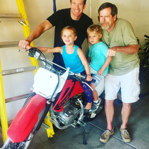 Bill with his son and grandkis on motorbike